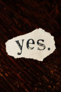 The Word Yes Ripped Out of a Magazine