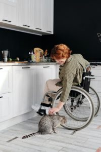 disabled woman in wheel chair with cat